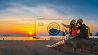 Obraz Romantic couple traveler joy look beautiful nature at sunset Pak Meng beach Outdoor lifestyle attraction travel Trang Thailand exotic beach Tourist on summer holiday vacation, Tourism destination Asia