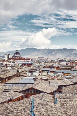 Roofs of Dukezong, Shangri La old town skyline, color toning applied, Diqing Tibetan Autonomous Prefecture, China.