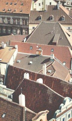 Roofs of Prague, retro toned picture, Czech Republic.