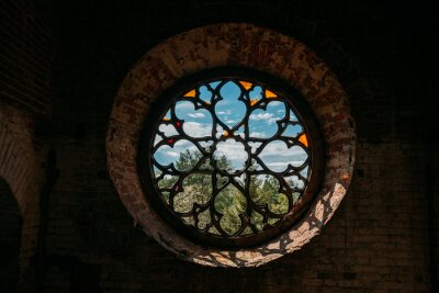 Obraz Round stained glass window in old abandoned castle