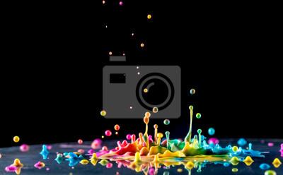 Obraz rozpryskiwania kolorowy tusz na czarnym tle
