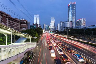 Rush hour in Jakarta business district in Indonesia capital city with traffic captured with blurred motion