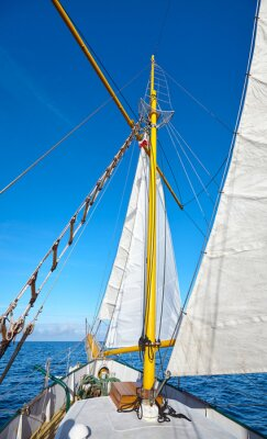 Sailing old schooner on a beautiful sunny day.