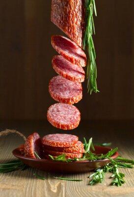 Obraz salami z rozmarynem