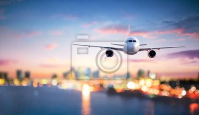 Obraz Samolot W Locie O Zmierzchu Z Niewyraźne Pejzaż