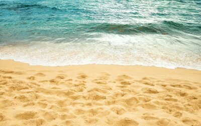 Sandy beach and ocean water edge, summer background.