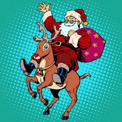 Obraz Santa Claus with gifts Christmas reindeer Rudolf