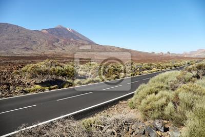Scenic asphalt road with Teide volcano in distance, Teide National Park, Tenerife, Spain.