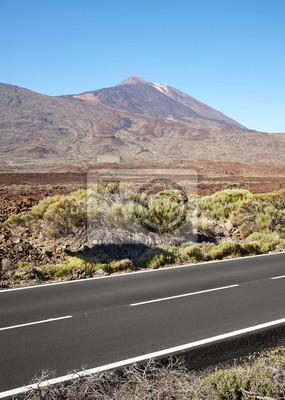 Scenic asphalt road with Teide volcano in distance, Tenerife, Spain.