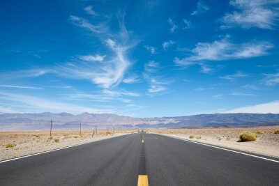 Scenic empty desert road in the Death Valley, USA.