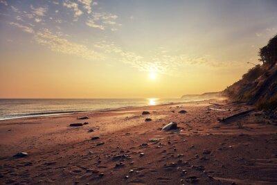 Scenic golden sunrise over Baltic Sea near Miedzyzdroje, Poland.