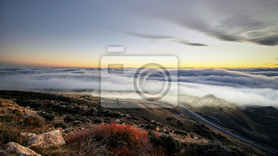 Scenic mountain landscape above the clouds at sunset, Wyoming, USA.