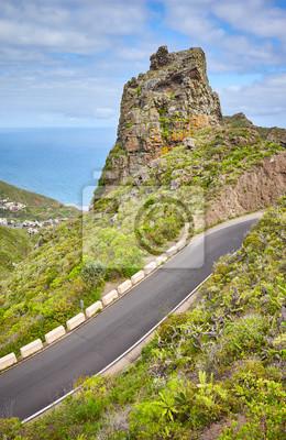 Scenic mountain road with Atlantic Ocean in distance in Anaga Rural Park, Tenerife, Spain.