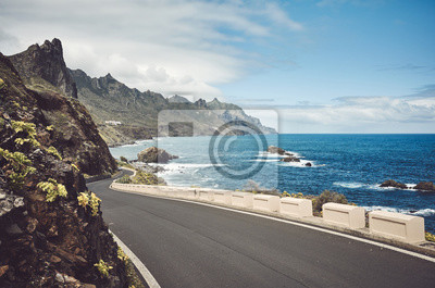 Scenic ocean road by the cliffs of the Macizo de Anaga mountain range, color toning applied, Tenerife, Spain.