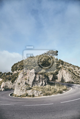 Scenic road bend in Anaga mountain range, color toning applied, Tenerife, Spain.
