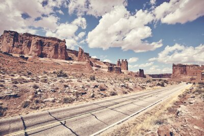 Scenic road in Arches National Park, color toning applied, Utah, USA.