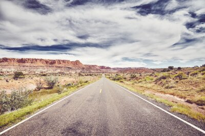Scenic road in Capitol Reef National Park, vintage color toning applied, Utah, USA.