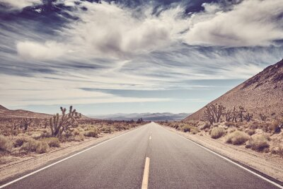 Scenic road in the Death Valley, color toning applied, USA.