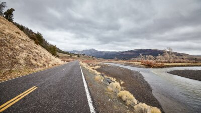 Scenic road on a rainy day in Yellowstone National Park, Wyoming, USA.