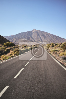 Scenic road with Mount Teide in background, color toning applied, Teide National Park, Tenerife, Spain.