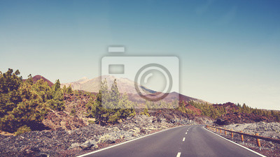Scenic road with Teide Volcano in distance, color toning applied, Tenerife, Spain.