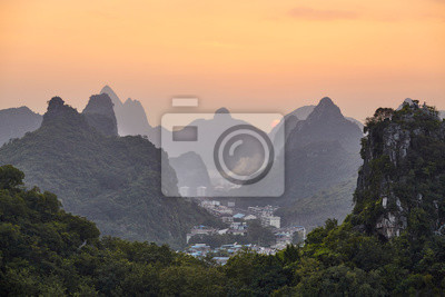 Scenic sunset over Karst mountains in Guilin, China.