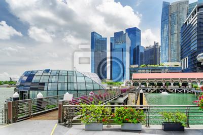 Scenic view of pedestrian bridge among skyscrapers in Singapore