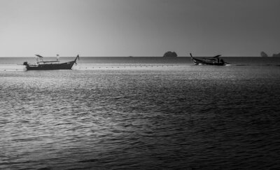 Sea sunrise or sunset with fishing boat in morning light, Black and white and monochrome style