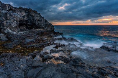 sea sunset at volcanic stones  beach