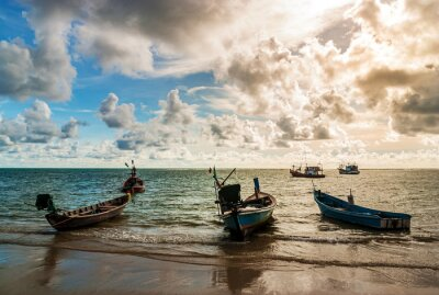Sea sunset or sunrise with fishing boat and colorful of sky and cloud in sunlight