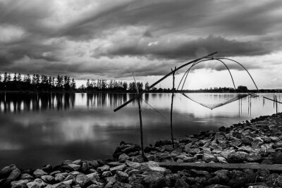Sea sunset or sunrise with fishing tool countryside and colorful of sky in twilight, Black and white and monochrome style