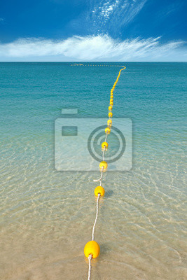 Several yellow buoys on the clear crystal water.