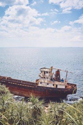 Shipwreck at a beach, Sri Lanka west coast, color toning applied.
