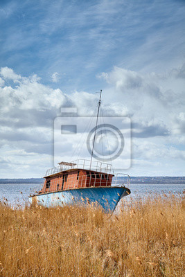 Shipwreck at Dabie lake in Lubczyna on a sunny day, Poland.