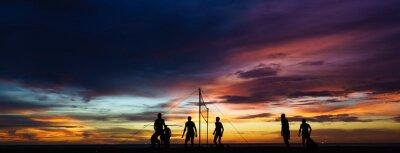 Obraz Siatkówka plażowa sylwetka o zachodzie słońca