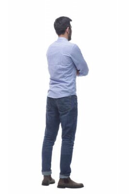 Obraz side view . casual young man reading an ad on a white screen.