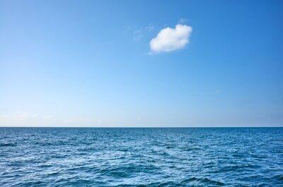 Single cloud over the ocean on a sunny day.