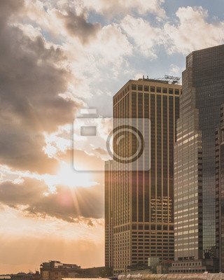 Obraz Skyscrapers of Manhattan against sunset, in New York City, USA