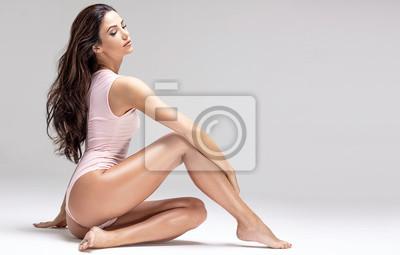 Obraz Slim beautiful girl posing in studio.