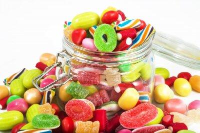 Obraz Słoik pełen cukierki samodzielnie na białym tle
