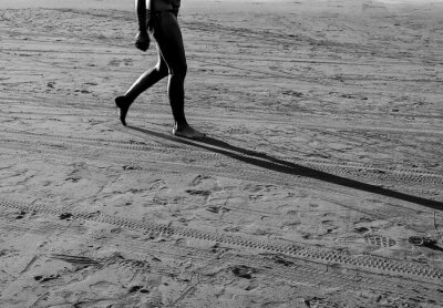 Some people walking on the sand beach in sunset, Black and white and monochrome style