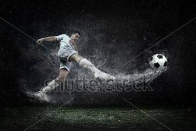 Obraz Splash of drops around football player under water