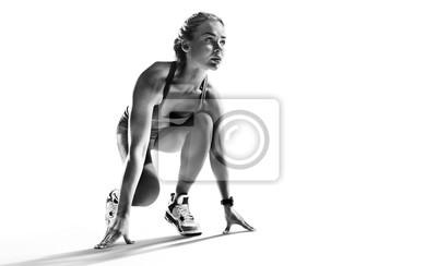 Obraz Sports background. Runner on the start. Black and white image isolated on white.