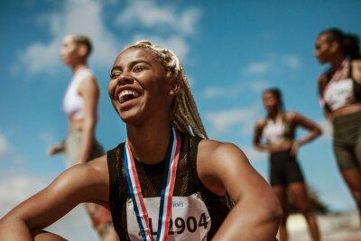 Obraz Sportswoman with medal celebrating her victory