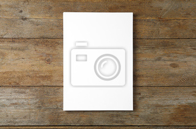 Obraz Stack of blank paper sheets for brochure on wooden background, top view. Mock up