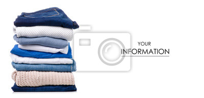 Obraz Stack of clothing jeans sweaters pattern on a white background isolation