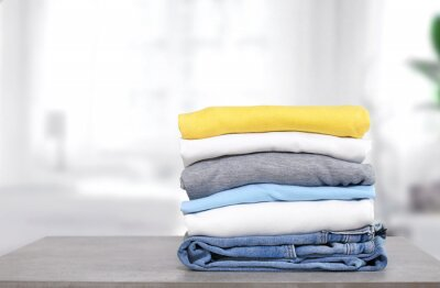Obraz Stack of cotton colorful clothes on table indoors.Stacked apparel.Folded clean clothing.