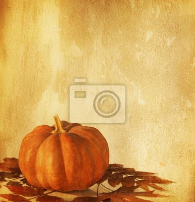 Stare papieru z dyni i suchych liści jesienią