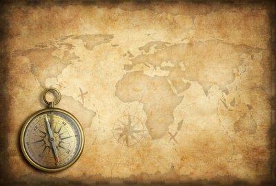 Obraz Stary mosiądz lub złoty kompas tle mapy świata
