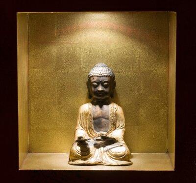Obraz Statua Budha na półkę z górnego światła